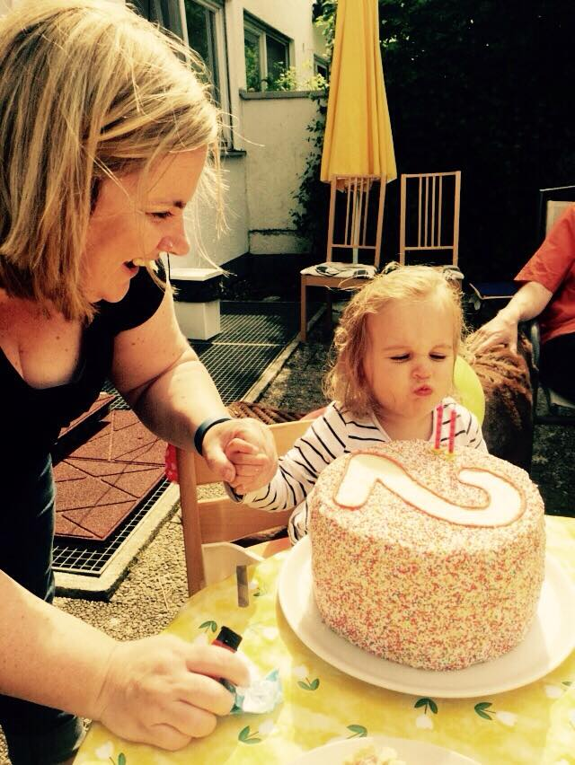 Totally unrelated but incredibly gorgeous shot of my sweet girl, determined to blow those two candles OUT!